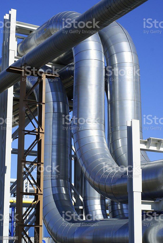 industrial pipelines on pipe-bridge against blue sky royalty-free stock photo
