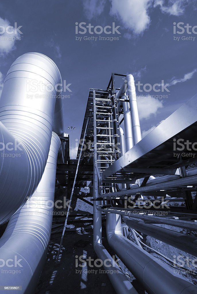 industrial pipelines on pipe-bridge in blue tone royalty-free stock photo