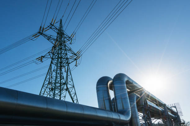 Industrial pipelines Industrial pipelines on pipe-bridge against blue sky power line stock pictures, royalty-free photos & images