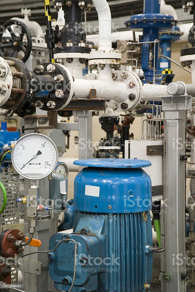 Industrial pipes and pump royalty-free stock photo