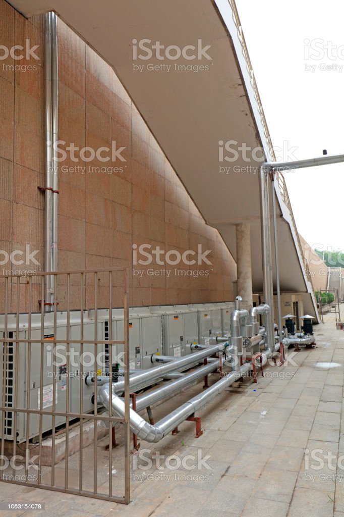 Industrial pipes are in a factory stock photo