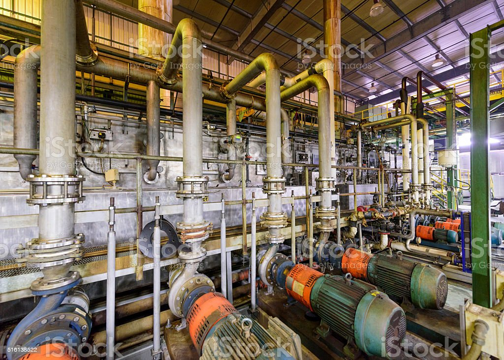 Industrial pipes inside aluminium processing plant stock photo