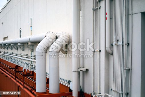 istock Industrial Piping Works and Water pipe engineering, clean line watering transport system in the building 1035549570