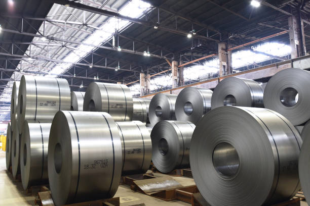 industrial plant for the production of sheet metal in a steel mill - storage of sheet rolls stock photo