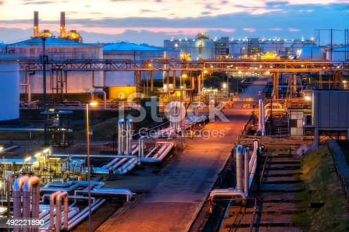 modern refinery illuminated at dusk, elevated view, long exposure with tripod, HDR image with digital blending