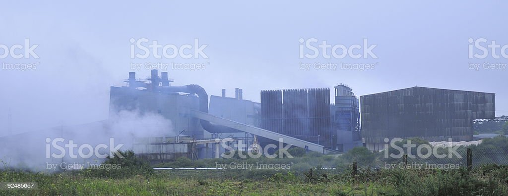 industrial plant in dawn mist royalty-free stock photo