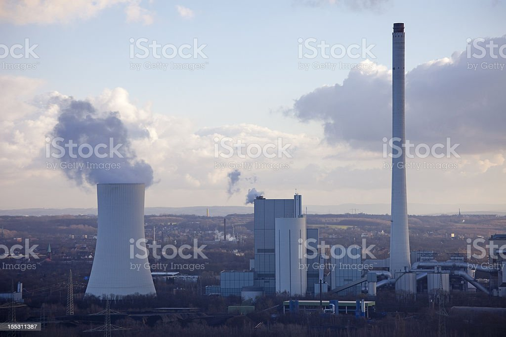 Industrial Plant with smoking Cooling Tower royalty-free stock photo
