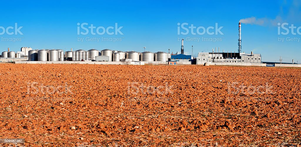 industrial plant with store buildings near field stock photo