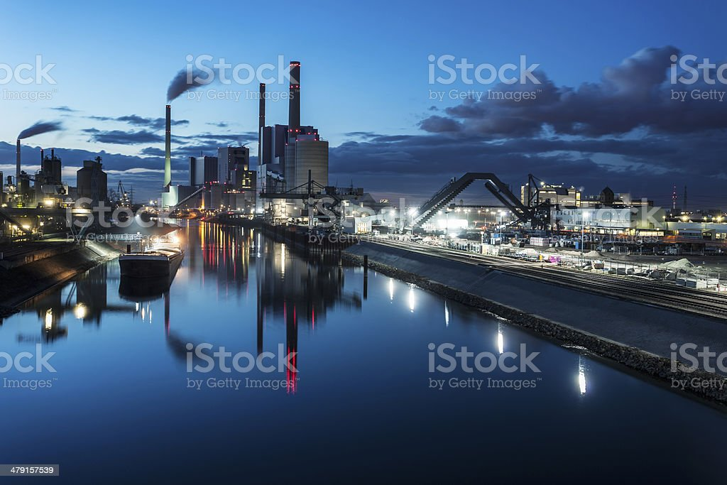 Industrial plants in the distance at night stock photo