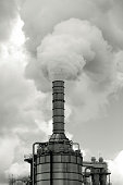 Industrial pollution, smoke from factory stacks, background with copy space, full frame vertical composition
