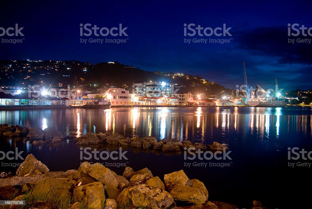 industrial; port at night with cargo vessel offloading and loading royalty-free stock photo