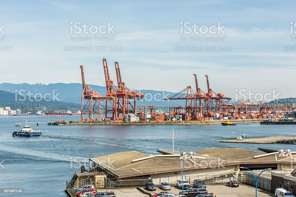 Industrial port with cranes at Vancouver harbour stock photo