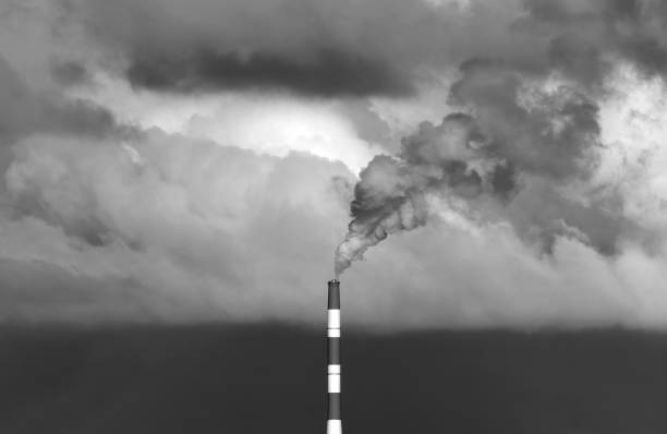 Industrial power station and smoke black and white image stock photo