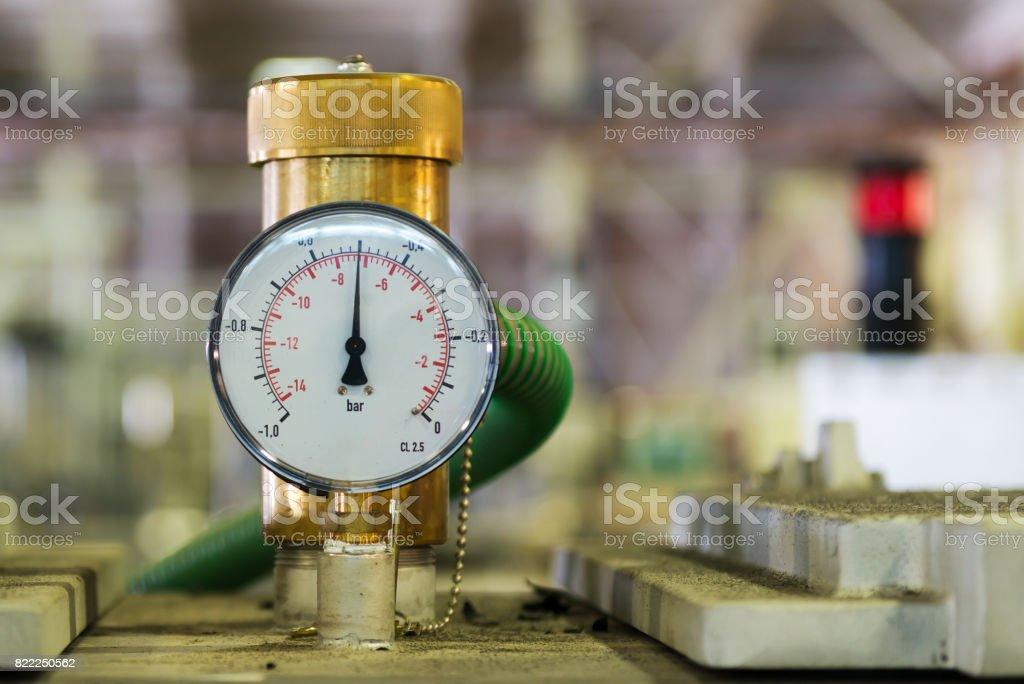 Industrial pressure meter - barometer and water pipes stock photo