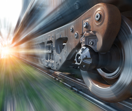 Industrial rail train wheels closeup technology perspective conceptual composition