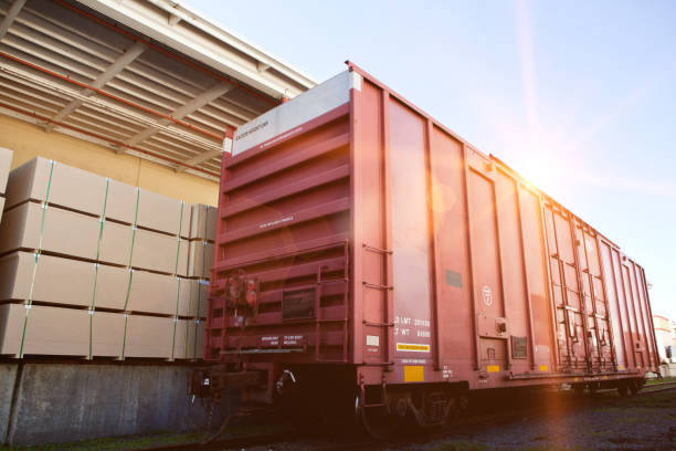 Industrial railway carriage transporting Lumber by rail stock photo