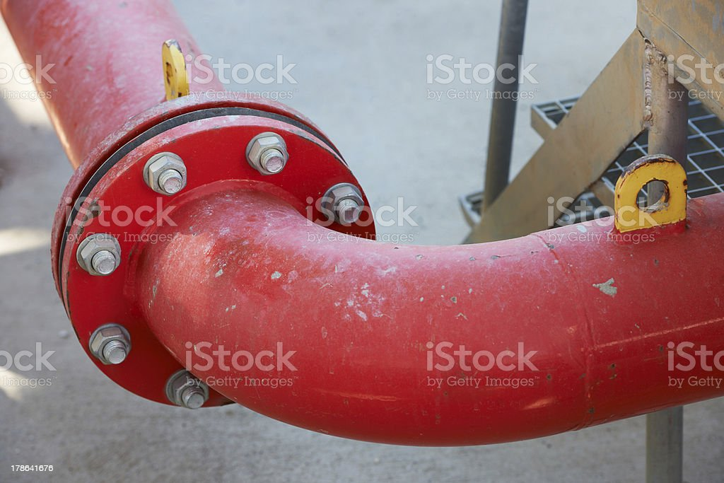 Industrial red pipe and flange royalty-free stock photo