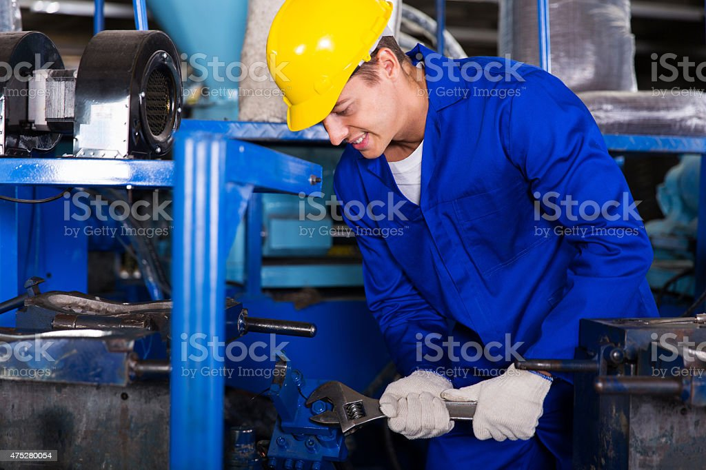 industrial repairman using wrench stock photo