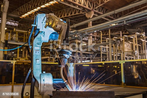 693576566 istock photo Industrial robot are test run new program in automotive assembly factory 876538606