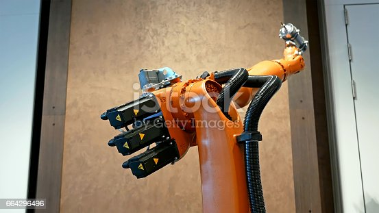 istock Industrial robot arm for welding and assembling 664296496