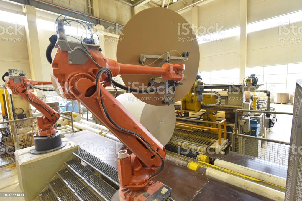 Industrial robot in a paper mill - automation in a modern plant -...