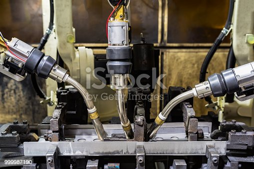 693576566 istock photo Industrial robot is in teaching mode it is learning new program in car factory 999987190