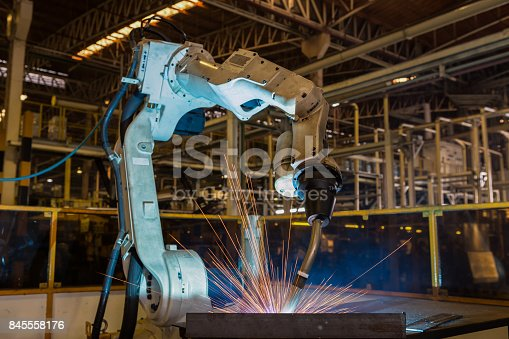 518201052istockphoto Industrial robot is test run new program in car factory 845558176