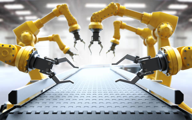 industrial robotic arms - automated stock photos and pictures