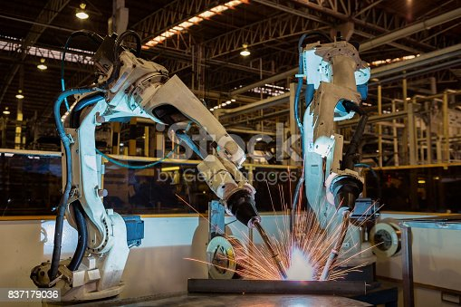 156642859 istock photo Industrial robots are welding assembly automotive part in car factory 837179036