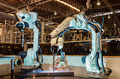 Industrial robots are welding assembly automotive part in car factory