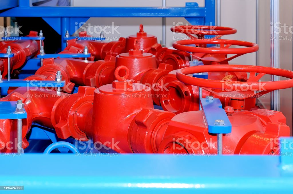 Industrial rotary valve and piping of red color. royalty-free stock photo