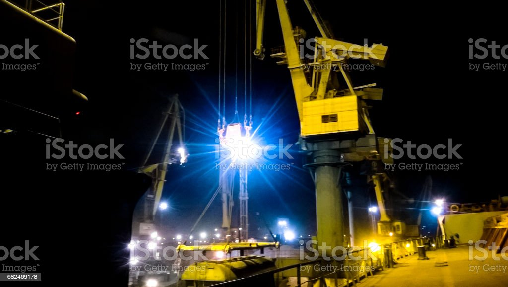Industrial seaport at night. The rotation of the car with grain royalty-free stock photo