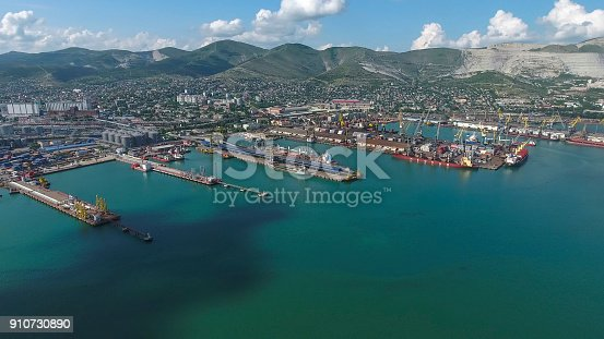 istock Industrial seaport, top view. Port cranes and cargo ships and barges. 910730890