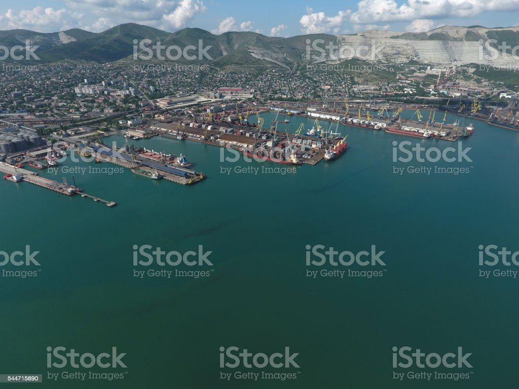 Industrial seaport, top view. Port cranes and cargo ships. stock photo