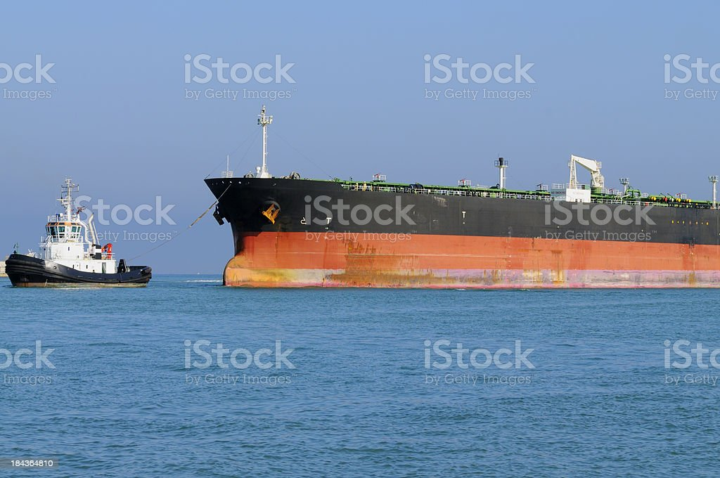 Industrial Ship and Tugboat royalty-free stock photo