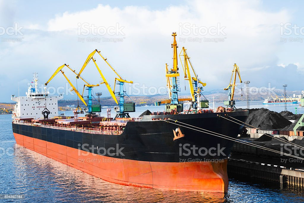 Industrial ship is at berth cargo in the port. stock photo