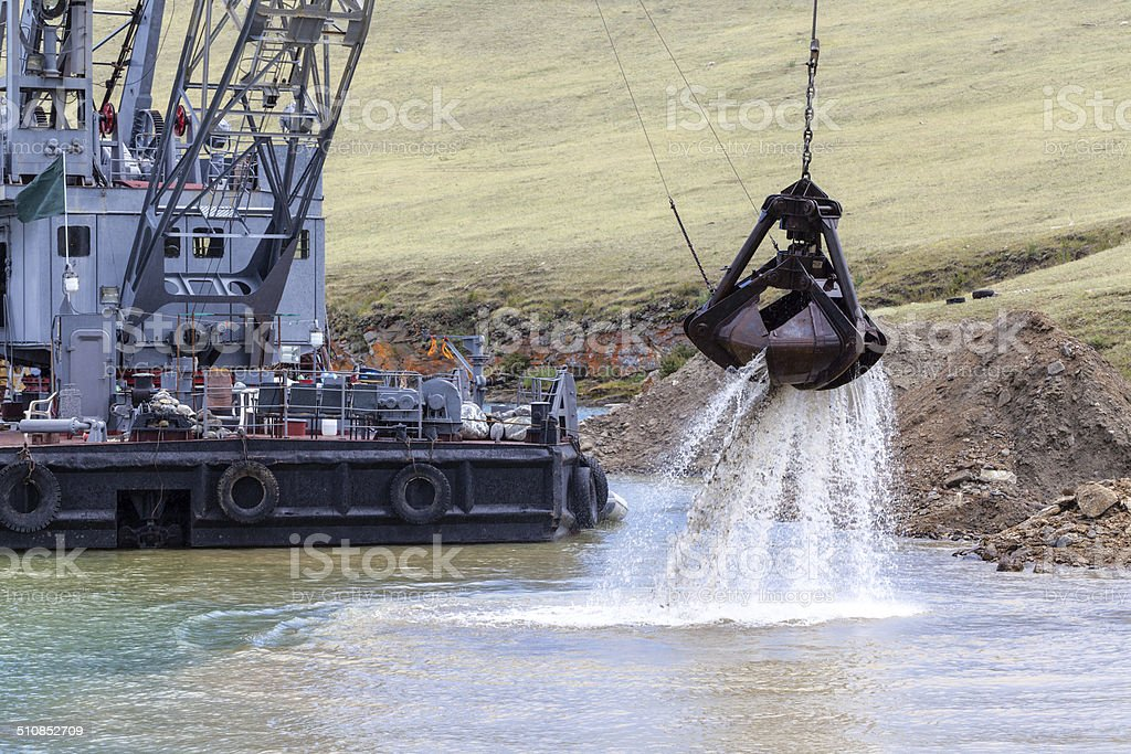 Industrial ship that digs sand stock photo
