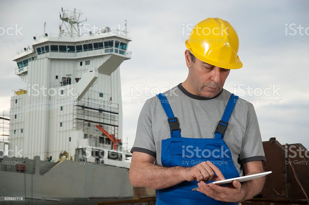 Industrial Ship worker using digital tablet stock photo
