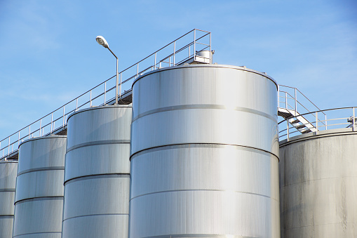 Detail of chemical plant, silos and pipes .
