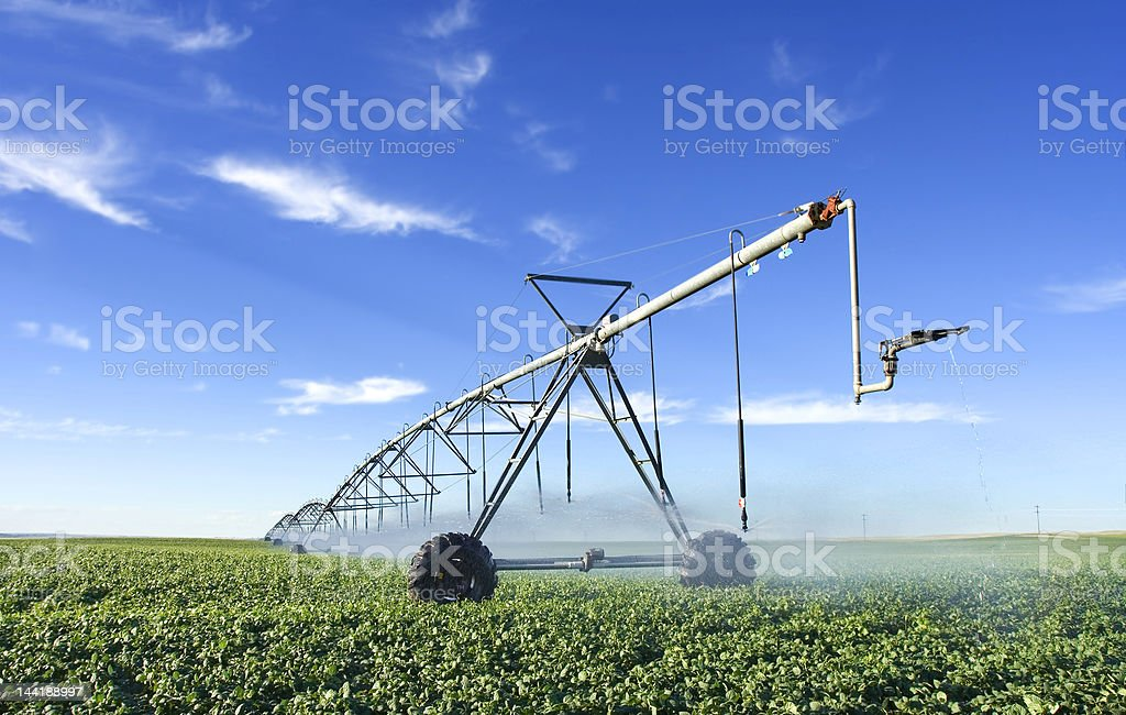 Industrial sized pivot in the field stock photo