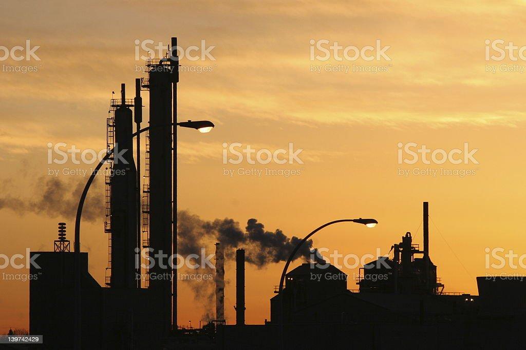 Industrial skyline against evening sun royalty-free stock photo