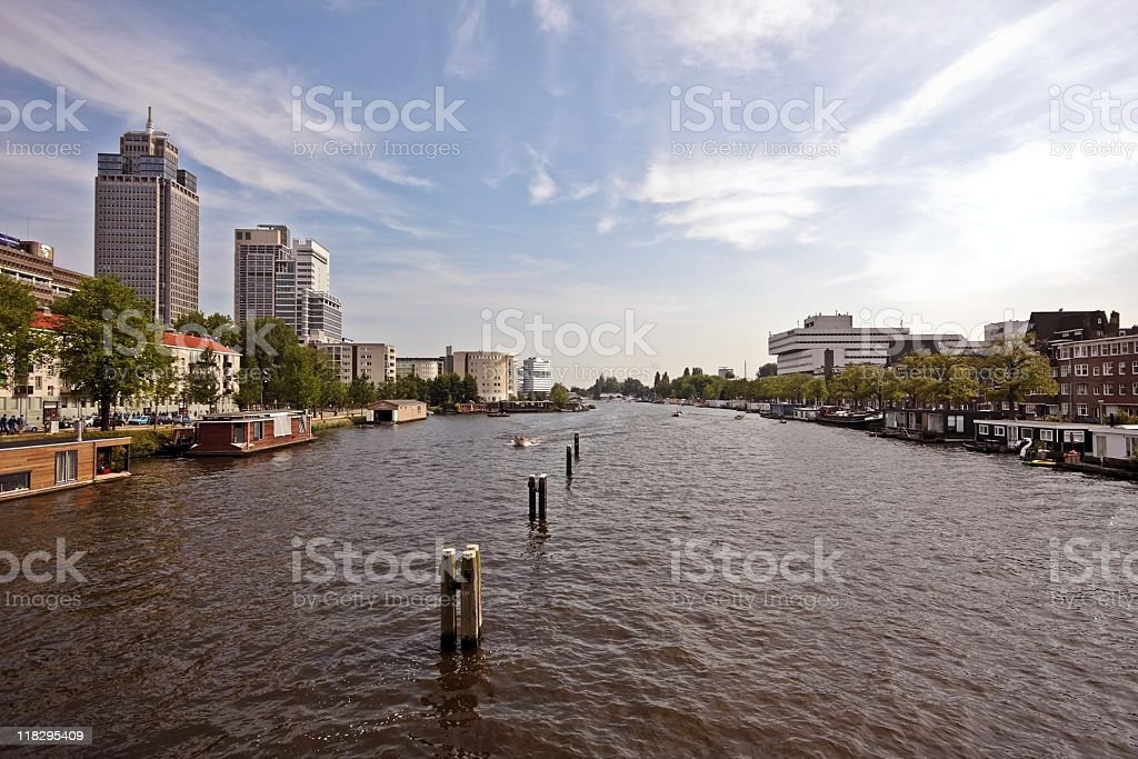 Industrial skyscrapers along the Amstel in Amsterdam Netherlands stock photo
