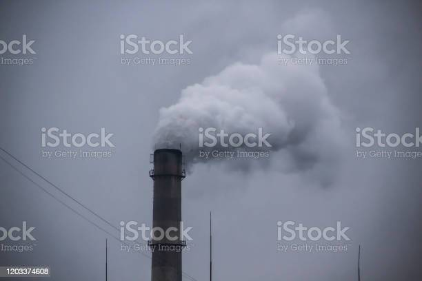 Industrial smoke pipe against grey sky industrial chimney fume mix in picture id1203374608?b=1&k=6&m=1203374608&s=612x612&h=dlasvrb ifxpa4e6zbndhw3j s 8y1tvbis80cpumx4=