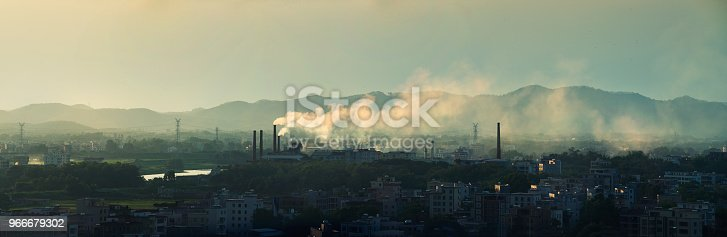 Industrial smokestacks and cities