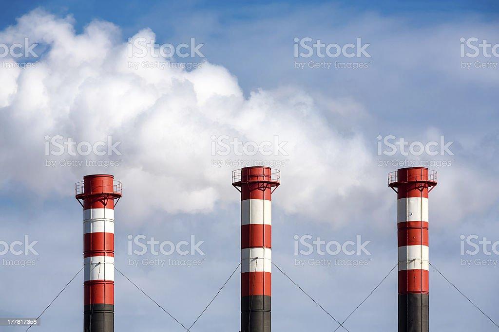 Industrial smokestacks stock photo