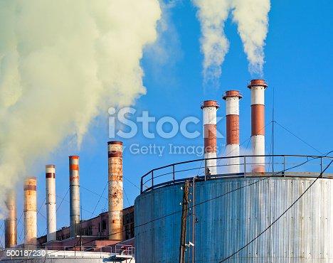 istock Industrial smoking chimneys against the blue sky 500187230