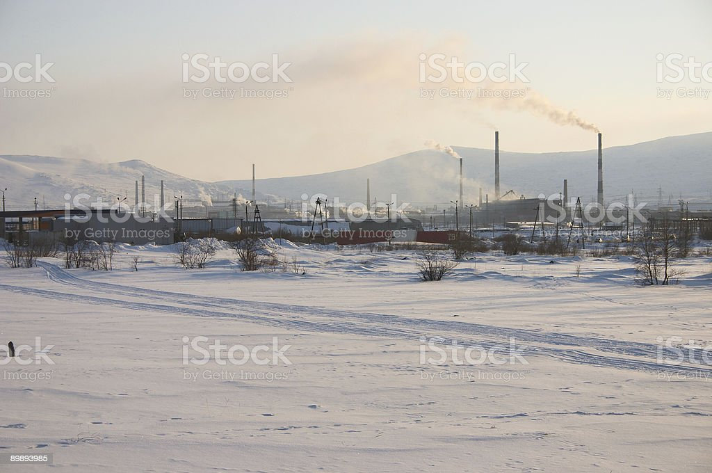 Industrial snowy landscape with mountain background royalty-free stock photo