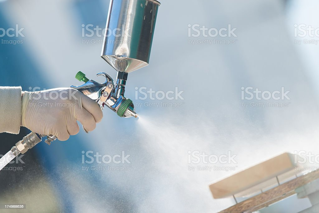 Industrial spray painting wood stock photo
