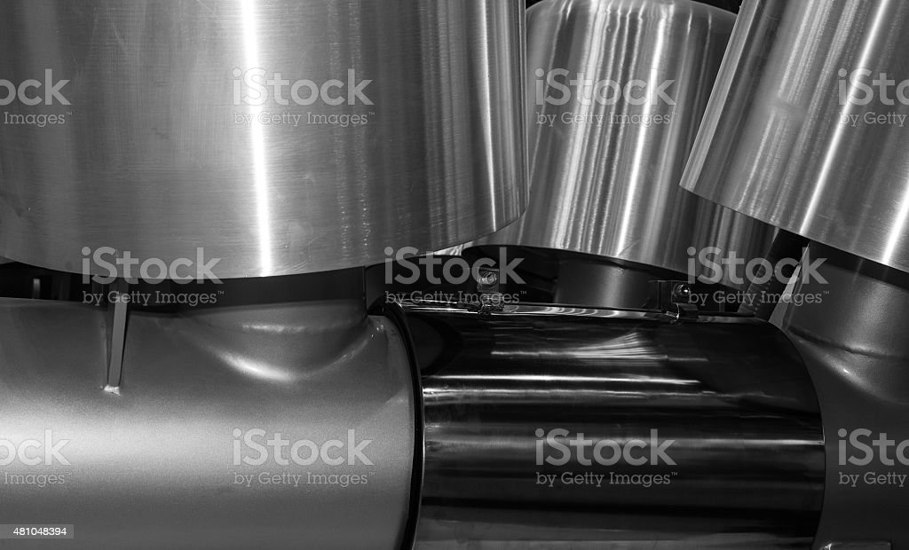 Industrial steel cylinders, pistons and tools in workshop. Industry...
