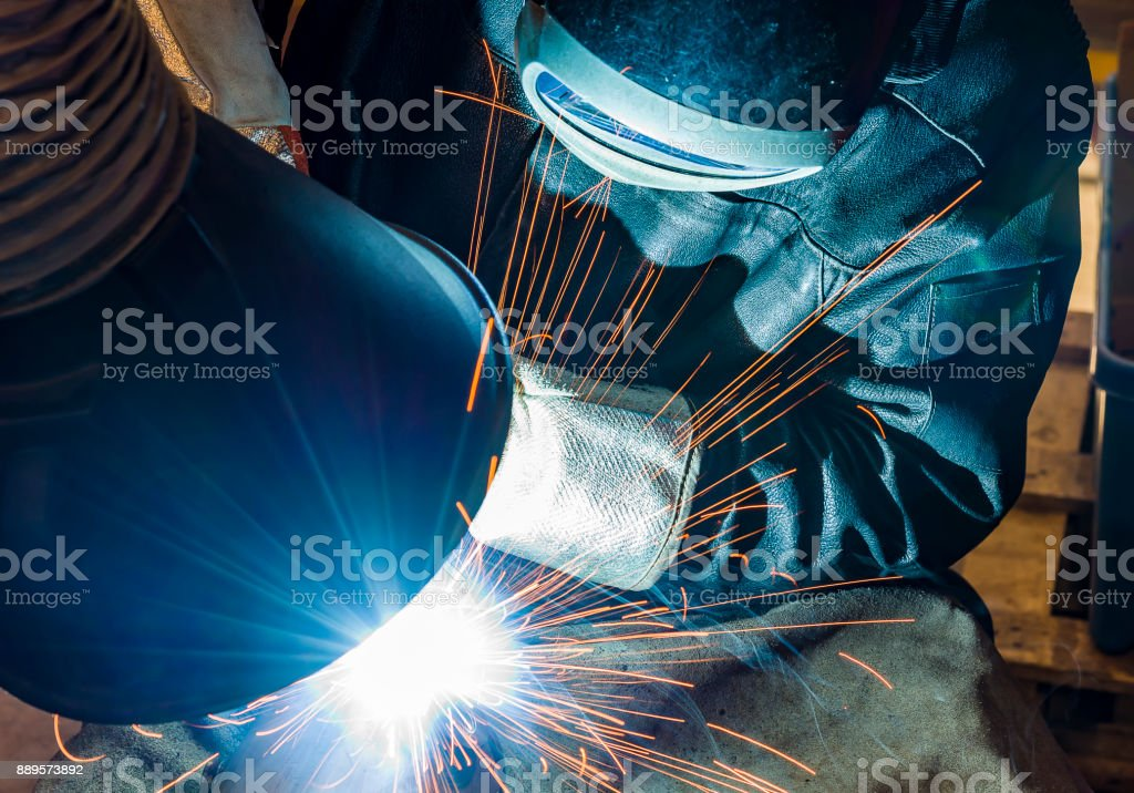Industrial steel welder in factory stock photo